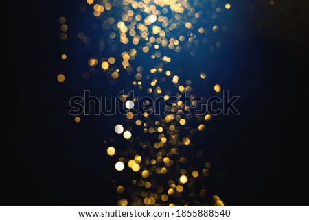 Golden abstract bokeh on dark blue background. Holiday concept Photo stock ©