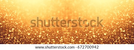 Golden abstract shimmering sparkles or glitter lights. Festive gold background. Defocused circles bokeh or particles. Template for design #672700942