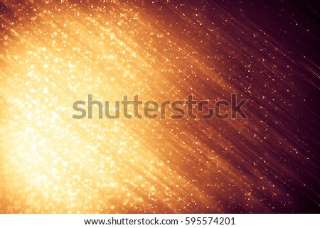 golden abstract sparkles or glitter lights festive gold background