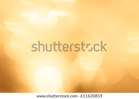 Golden abstract sparkles or glitter lights. Festive gold background. Defocused circles bokeh or particles. Template backdrop for design #611620859