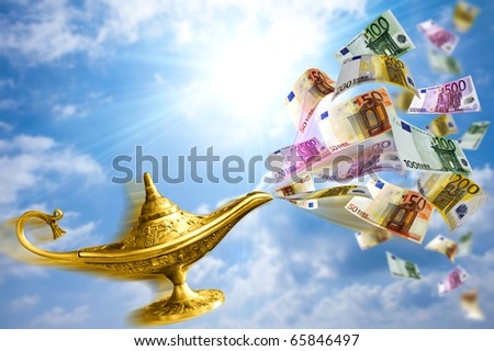 Golden Aladdin lamp with money desire