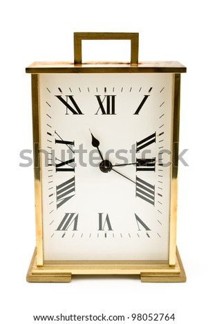 Golden alarm clock isolated on white