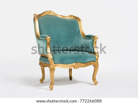 Golden and light blue classic armchair isolated on white background