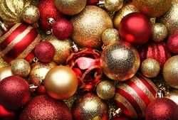Golden and red christmas baubles background