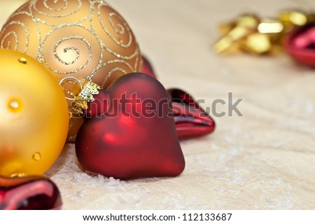 Golden and red glittery christmas ornaments as a background