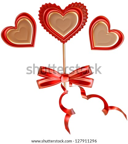 golden and red lollipop tied with a bow and long ribbons decorated two hearts