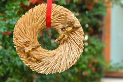 Golden angels on a straw wreath for Valentin's day or Christmas