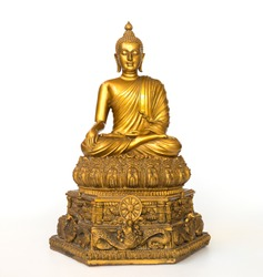 Golden antique buddha statue on the white background (isolated background). The face of the Buddha turned to the straight.