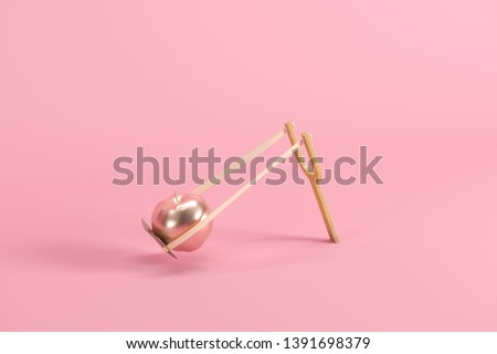 Golden apple in a slingshot on pink background. Minimal fruit idea concept. 3D render.