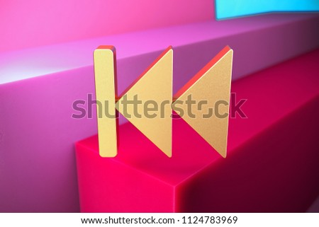 Golden Arrow Fast Backward Icon on the Magenta and Cyan Geometric Background. 3D Illustration of Gold Arrow, Audio, Back, Backward, Button, Fast, Left Icon Set With Color Boxes on Magenta Background.
