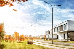 golden autumn landscape in modern city against blue sky background street wide view of fall season in town concept with cottages in residential area road and park urban cityscape landmark