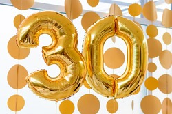 Golden balloons with ribbons - Number 30. Party decoration, anniversary sign for happy holiday, celebration, birthday, carnival, new year. Metallic design balloon.
