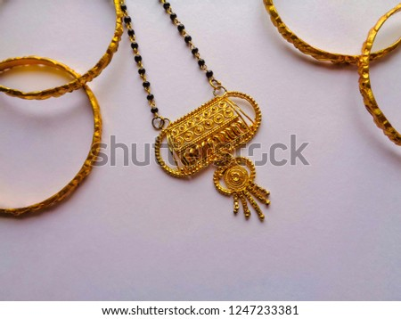 Golden bangles and necklace for someone's gift, golden bangles and necklace isolated on white background #1247233381