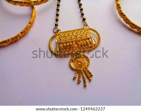 Golden bangles and necklace for someone's gift, golden bangles and necklace isolated on white background #1249462237