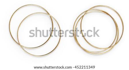 Golden bangles arranged. Isolated object on white background.