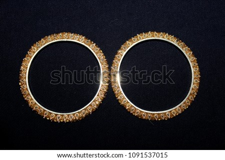 Golden bangles shimmer shiny festive - Shutterstock ID 1091537015