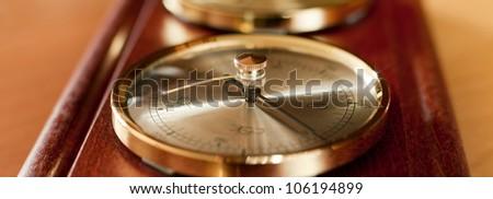 Golden barometer forecasting sunny weather