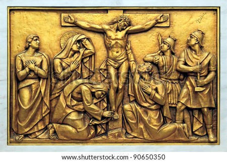 Golden bas-relief of the old Basilica of Fatima representing one of the fourteen mysteries of the rosary, similar to the stations of the cross. This bas-relief depicts Jesus Christ on the Cross.