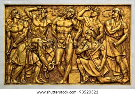 Golden bas-relief of the old Basilica of Fatima representing one of the fourteen mysteries of the rosary, similar to the stations of the cross