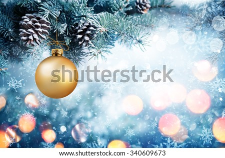 Golden Bauble Hanging Fir Branch With Snowfall #340609673