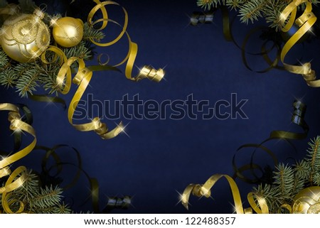 Golden baubles and ribbons on a dark blue background