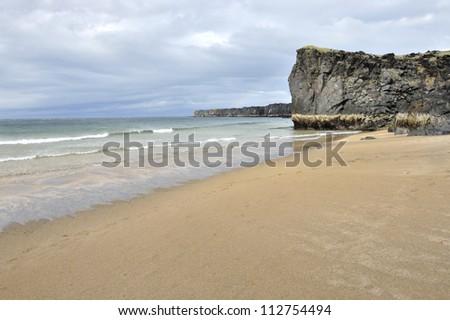Golden beach at Skardsvik, West Iceland. - stock photo