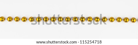 golden beads on white background