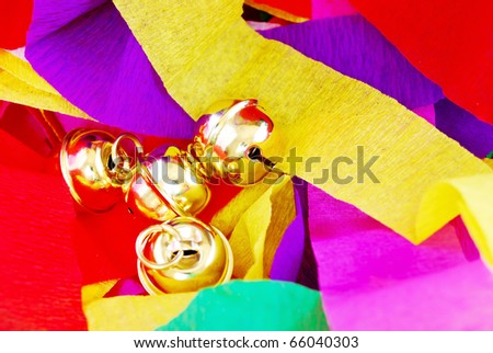 golden bell against colorful mulberry paper background