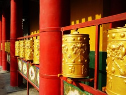 Golden Bell in a Buddhist Temple with red columns