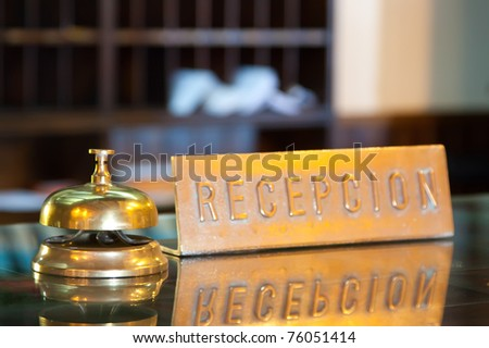 Golden bell on  reception desk in hotel