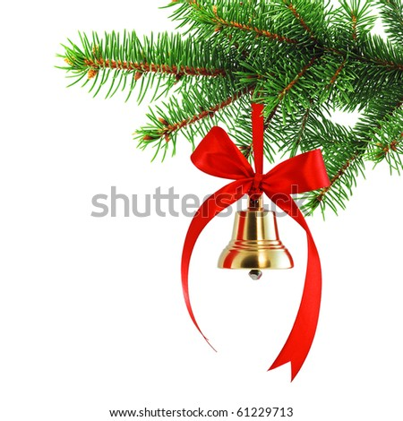 Golden bell with red satin ribbon bow hanging on a green spruce branch