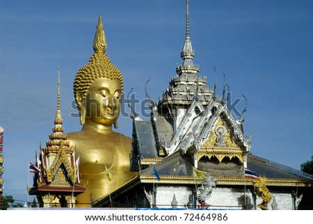 Golden big Buddha in outdoor at Middle Thailand temple.