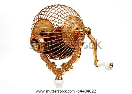 golden bingo sphere with wooden balls on white background