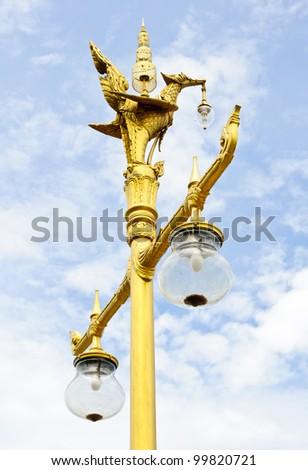 Golden bird statue on the top of lantern pole.