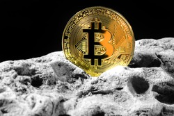 Golden Bitcoin Coin on grey rock . Bitcoin cryptocurrency. Business concept