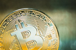 Golden Bitcoin on a luminous background. Close up