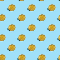 Golden bitcoin seamless pattern. Cryptocurrency Coins wit shadows repeat on blue background.
