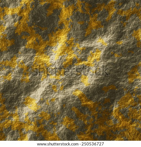 Golden blots splattered on grey stone. Texture or background.