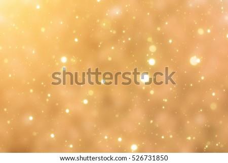 Golden bokeh or glitter lights festive background #526731850