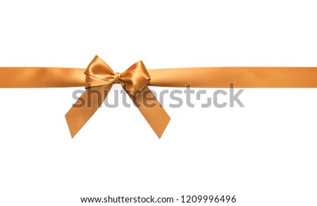 Golden bow on a white background. Preparation for a festive design. #1209996496