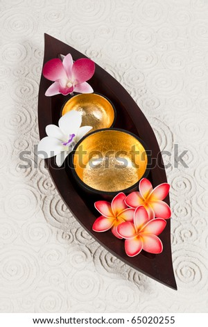 Golden bowl in the wooden leaf tray on paper background