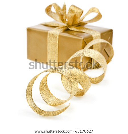 golden box with ribbon bow on white