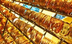 Golden bracelets in a jewelery shop at the Golden Souk market in Dubai, UAE