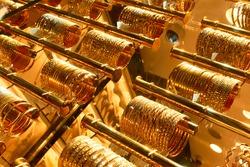 Golden bracelets in a jewelery shop on the Golden souk market in Dubai