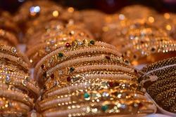 Golden bracelets in a jewellery shop