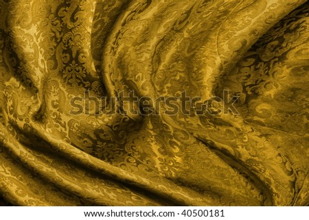 Golden brocade fabric with damask pattern folded background