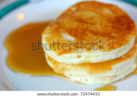 Golden brown pancakes topped with sweet syrup for a tasty breakfast.