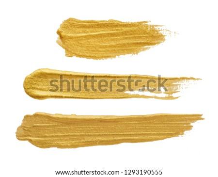 Golden brush stroke on white #1293190555