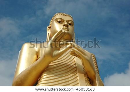 Golden Buddha at Dambulla - buddhist cave temple complex in Sri Lanka,world heritage
