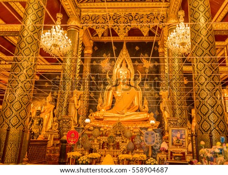 golden buddha at temple in Thailand.